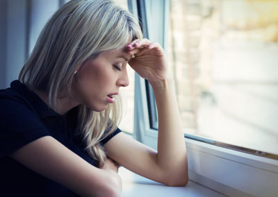 Woman suffering from mental health issues
