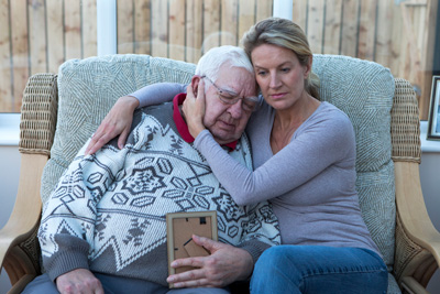 caregiver assisting an old man suffering of alzheimer