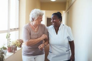 caregiver walking with an elderly person