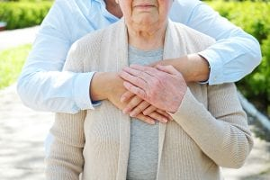 lady assisted by a caregiver